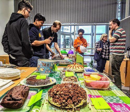 Team prepping cake room