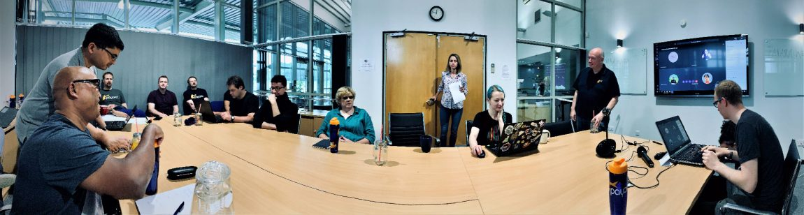 panorama of people sitting at a table